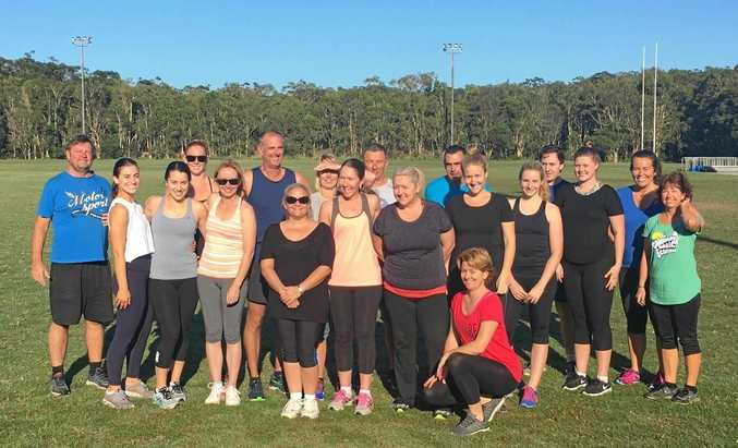 GETTING HEALTHY: The Henzells and Pelican Waters crew take a break from the huff and puff at one of their weekly fitness sessions