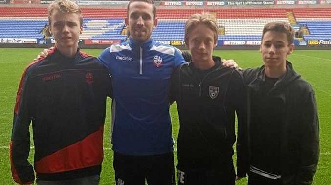 TOP TRIP: Louie Edwards, Toby Evens-Gilham and Jed Hetherington with Danny Clarke (middle) at Bolton Wanderers FC.