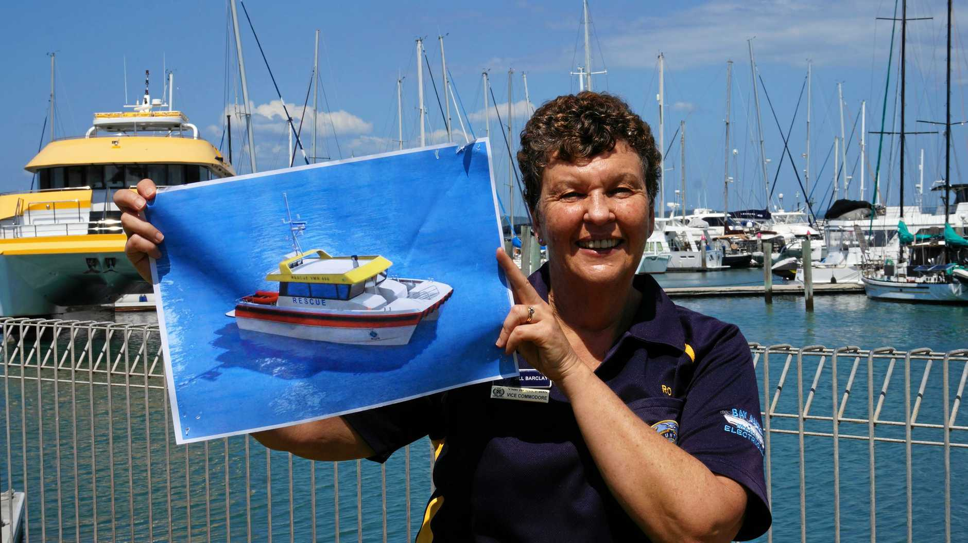 PROMISES AFLOAT: Vice commodore of Hervey Bay VMR Jill Barclay with draft designs for a new rescue vessel. The LNP has pledged $1 million for the boat.