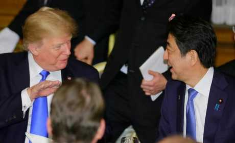 US President Donald Trump talks with Japanese Prime Minister Shinzo Abe at the opening of a welcome dinner hosted by Abe at Akasaka Palac. Picture: AFP/Shizuo Kambayashi