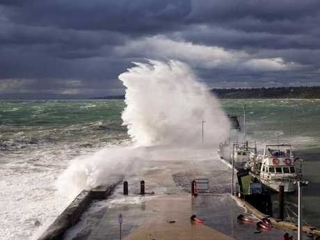A cold front brings powerful waves to Mornington Pier, Victoria. Picture: Jennifer Erlandsen