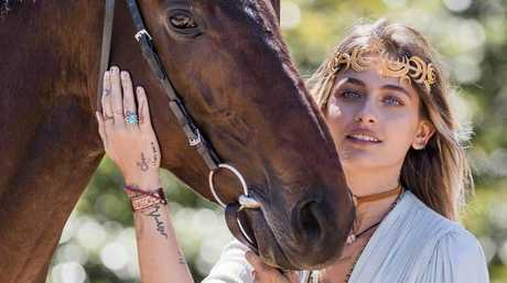 Paris Jackson ... if you are an international guest at the Melbourne Cup, make sure you have your photo taken with a horse. Picture: Jason Edwards