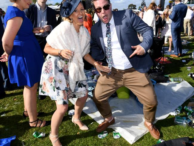 Racegoers strike a pose. Picture: Joe Castro/AAP