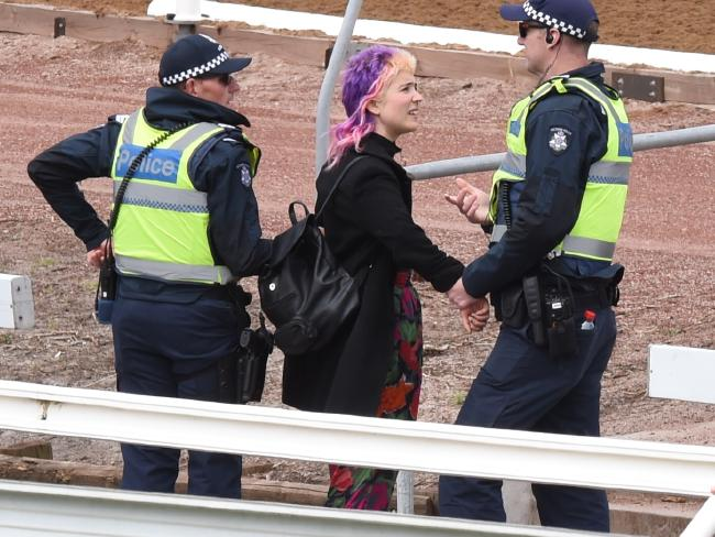 The young woman is stopped by police. Picture: Nicole Garmston