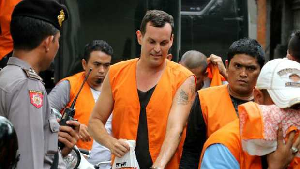 Australian Thomas William Harman pictured among the other prisoner as he arrived to Denpasar District Court for the trial on a theft case in Bali Airport in July. Picture: Lukman/ News Corp Australia