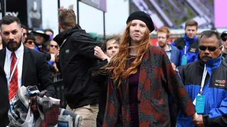 Refugee protesters are removed at Flemington Racecourse. Picture: AAP Image/Tracey Nearmy