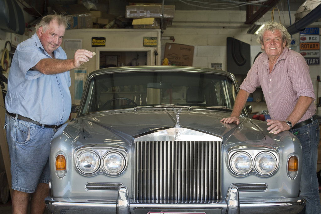 This 1973 Rolls Royce Silver Shadow owned by Chris Hope (left), with Roy Gorring of Toowoomba Auction Centre, will go to auction with a starting price of $1.