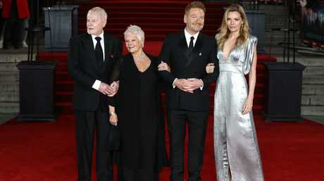 Cast members (L-R), British actors Derek Jacobi and Dame Judi Dench, British director and actor Kenneth Branagh and US actress Michelle Pfieffer arrive at the for the world premiere of Murder on the Orient Express at the Royal Albert Hall in Central London.