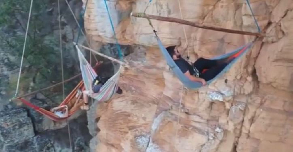 Seth Brumpton, Hayden Whip and Alex Caulfield spend the night suspended from cliffs near Toowoomba in hammocks.