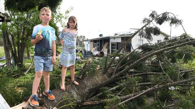 STORM DAMAGE: Marni and Bodie Hines in the yard of their Meadowvale home which suffered damage from a fallen tree.