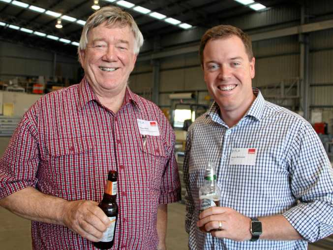 Rodney Banks (left) and Bruce McConnel enjoy a beer before the event starts.