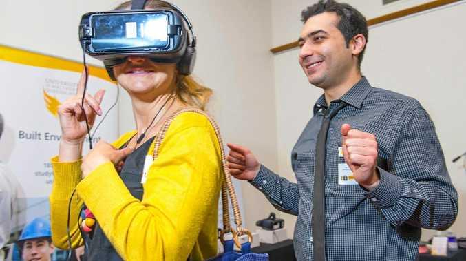 USQ's Dr Ali Mirzaghorbanali shows Joy Argow some new technology.