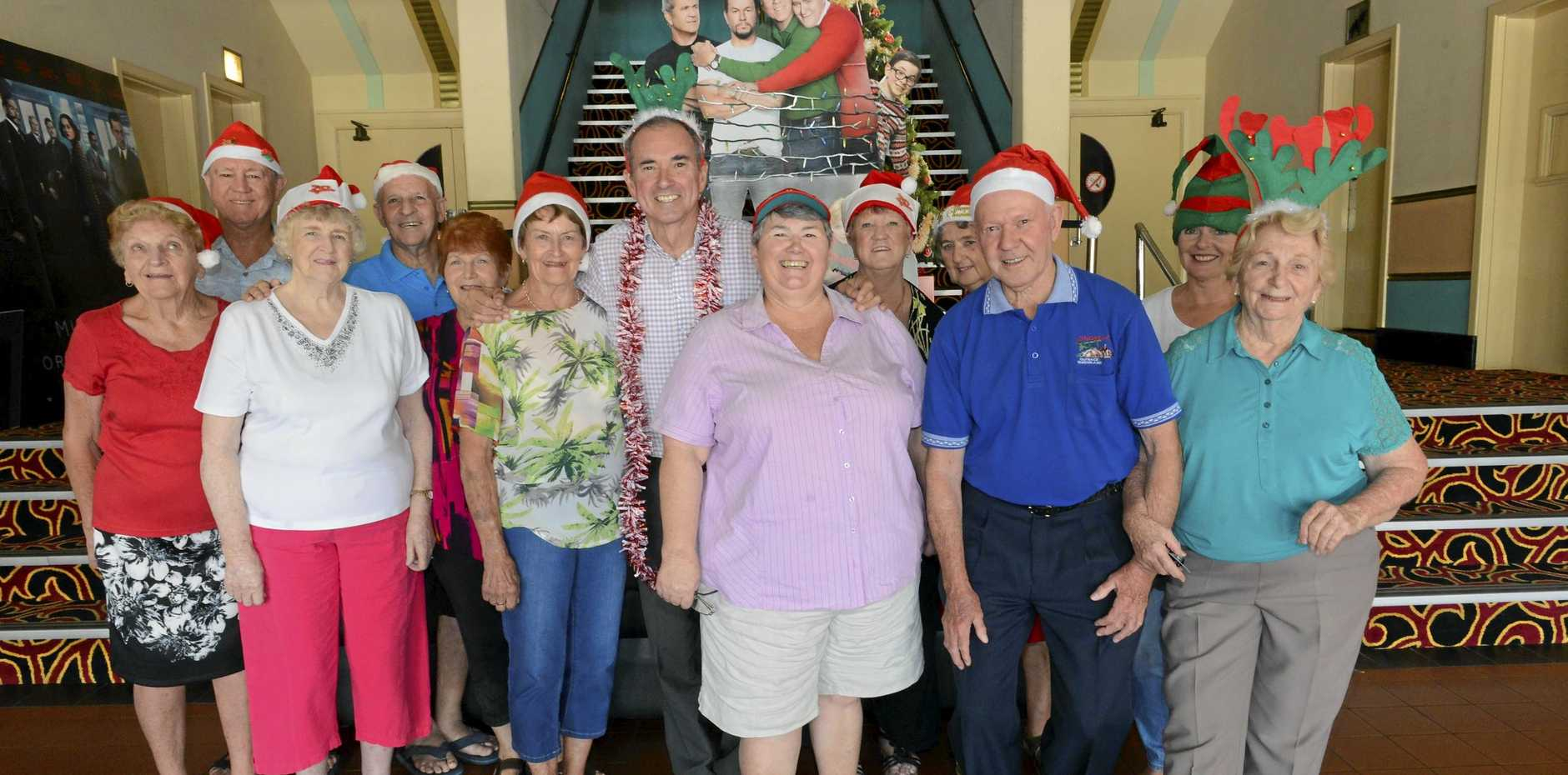 CHRISTMAS CHEER: Grafton senior citizens get into the festive spirit with Member for Clarence Chris Gulaptis in anticipation of the upcoming free concert at the Saraton Theatre featuring star of the stage Peter Cousens and country music artist Darren Coggan.