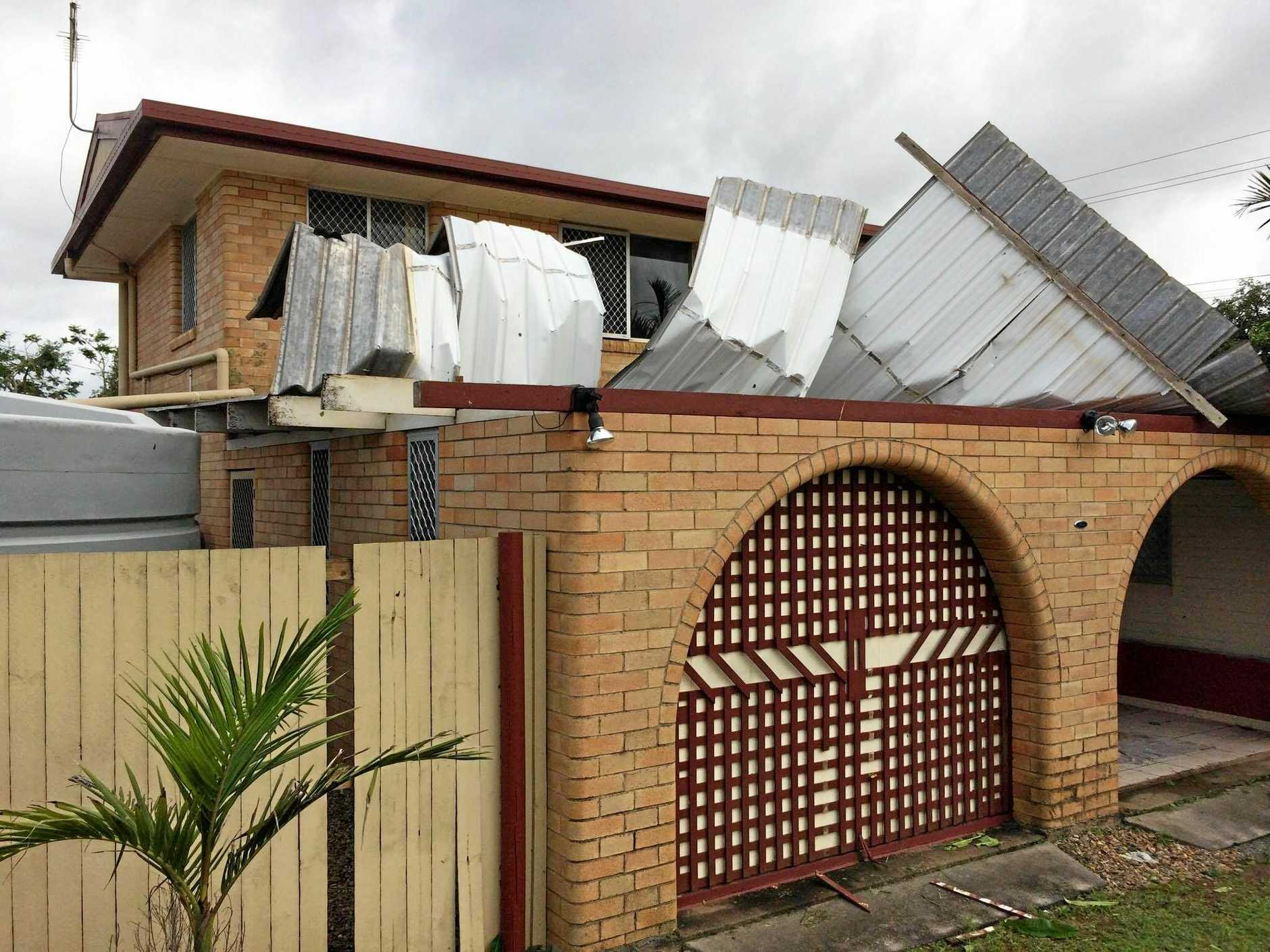 A home has lost its roof In Moore Park.