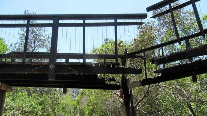 The damage at the boardwalk at Marcoola, after vandals lit fires in the area.
