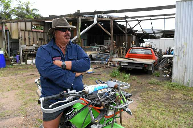 WILD WEATHER: Moore Park herb farmer Jim Cini in front of his shed, which was completely destroyed in the storm.