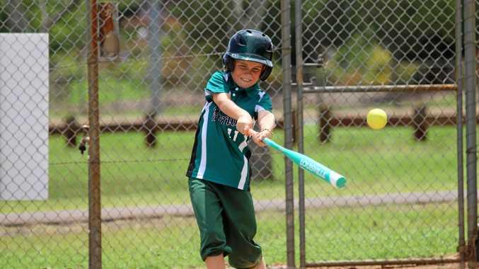 Warriors batter Flynn Edards swings hard and fast in the U11s Toowoomba Softball game.