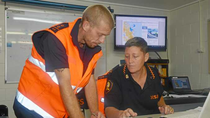COMMAND CENTRE: Narelle Field and Kieran Galey in the busy Bundaberg SES operations room today.