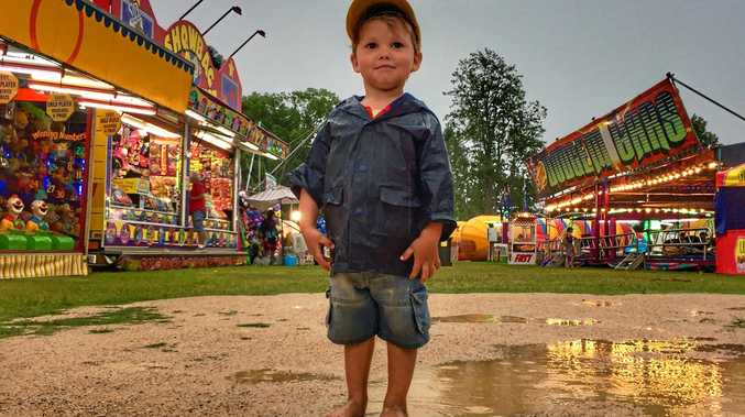 BORN SHOW MAN: Diesel Nilon a sixth generation showman had fun in the puddles down sideshow alley after a huge downpour swept over the Mullumbimby Show on 2016. The family travels to a different country show each week and his mother Melissa said Mullumbimby has been steadily building in popularity over recent years.
