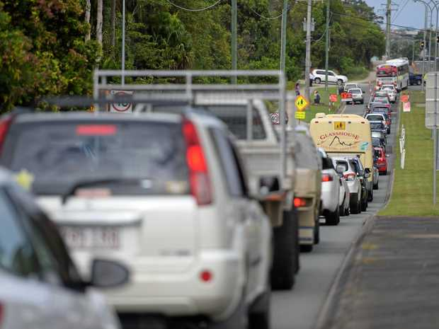 Traffic chaos on Parklands Blvd at Little Mountain outside Meridan State College at pick-up time.