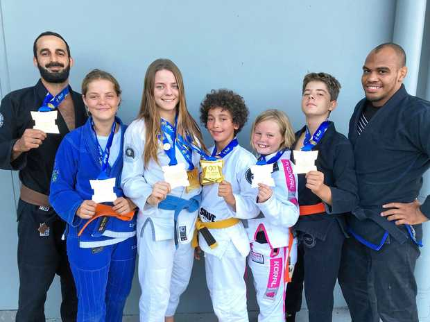 TEAM BYRON: Raz Harel, Skylah McCourt, Milli McCourt, Chilli Harel, Indi McCourt and Bryce McCourt with coach Daniel Almeida.