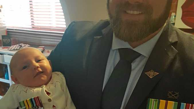 Gary Wilson and daughter Audrey on Anzac day this year. The mounted medals in this picture are replicas of his real medals, which are still in the box.