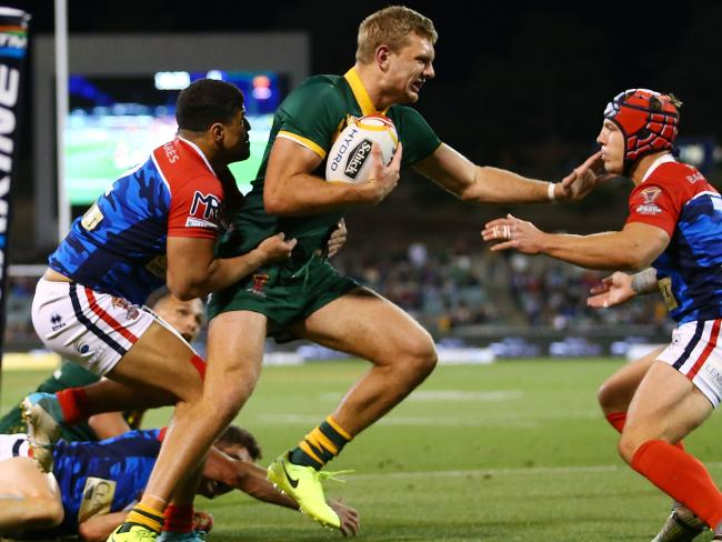 Tom Trbojevic of Australia is tackled by the USA.
