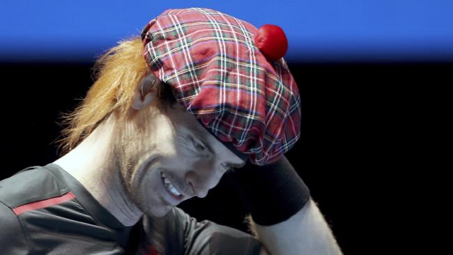 Andy Murray wears a Scottish tam o' shanter tartan hat with added ginger hair as he plays against Roger Federer, in their friendly singles match during the Andy Murray Live Event in Glasgow.