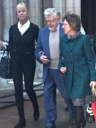 Rolf Harris and his niece Jenny (on his left) leave the Royal Courts of Justice in London. Picture: Ellen Whinnett