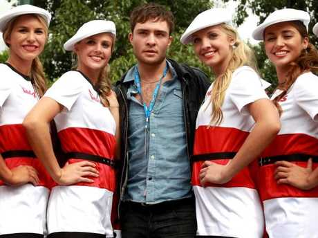 Ed Westwick with the Qantas Grid Girls at the 2011 Australian Grand Prix. Picture: Supplied