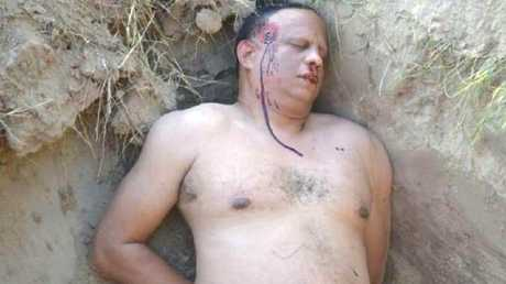 This fake photo Ramon Sosa lying dead in a makeshift grave was used to send his wife to jail. Picture: PA Real Life