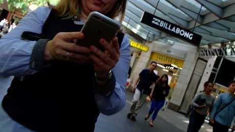 People love walking on their phones in the city.