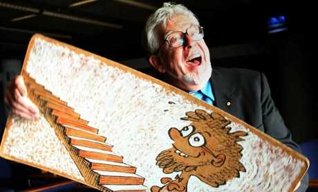 Entertainer Rolf Harris with his famous wobble board. Picture: Supplied