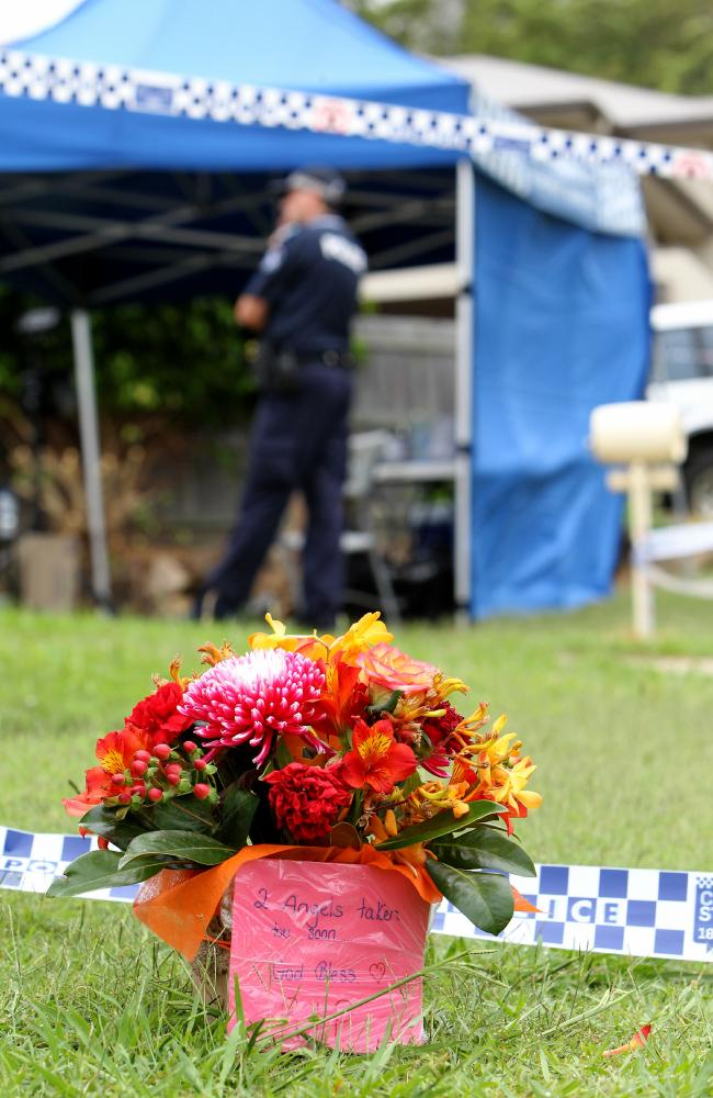 Local residents lay flowers at the scene of a Double Murder at Upper Coomera on the Gold Coast . Picture Mike Batterham