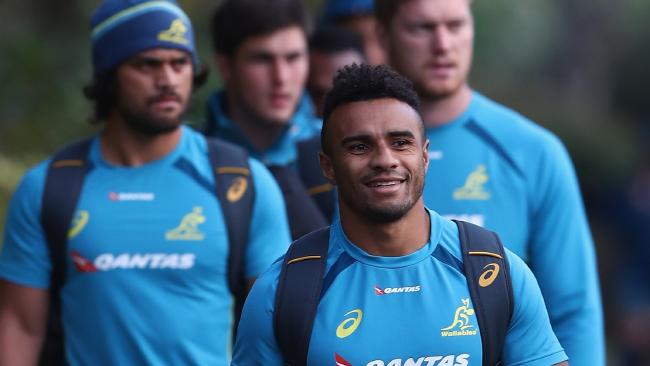 Will Genia walks towards a training session.