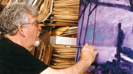 Rolf Harris painting in studio at his home in Bray, Berkshire in 2000. Picture: Natalie Gray.