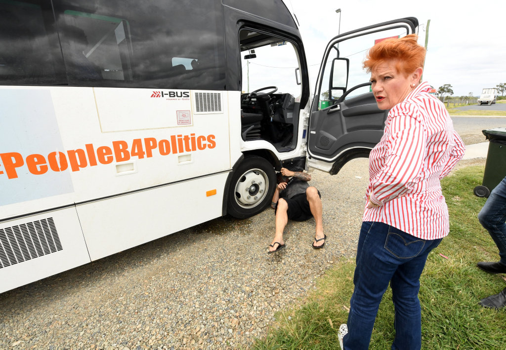 One Nation leader Pauline Hanson looks on as a truck driver stops to inspect the 'Battler Bus' after a break down in Marlborough, north of Rockhampton.