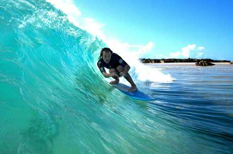 Sepsis survivor Jason Gall catching a barrel back in his surfing days.