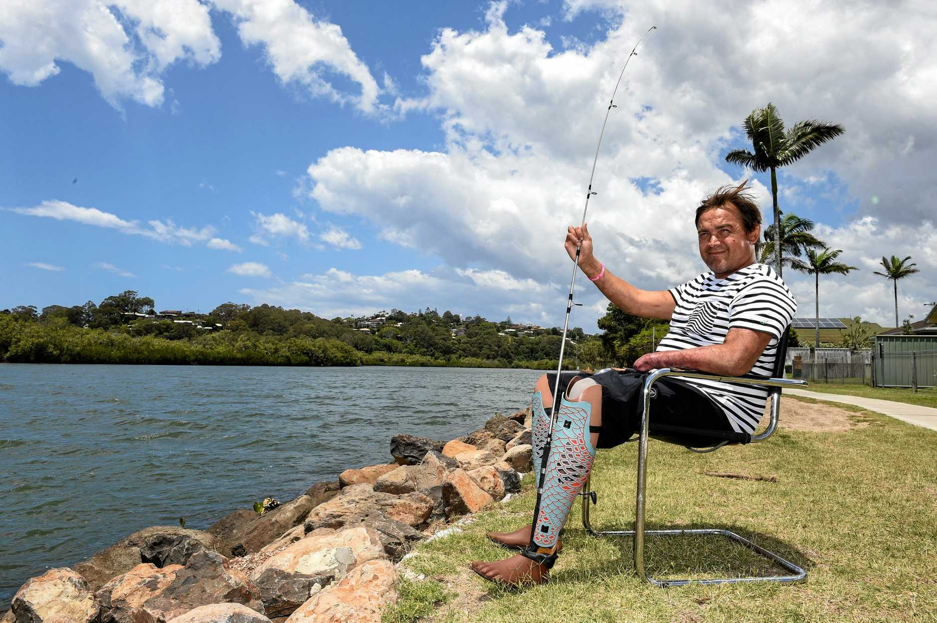 Jason Gall loves spending time fishing in the river behind his Tweed Heads West home.