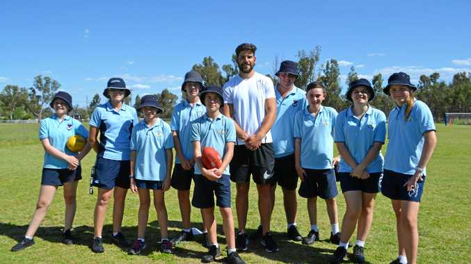 Carlton player Levi Casboult spends the day running AFL clinics for kids from Chinchilla Christian College.