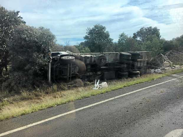 The truck overturned just off of the Warrego Hwy.