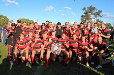 The Rockhampton Grammar School team celebrates its win at the Confraternity Shield.