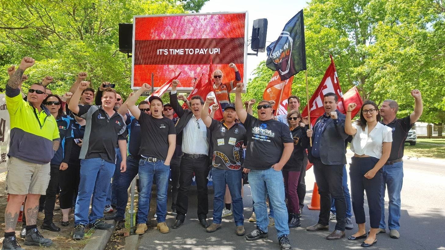JOBS LOST:  Cook Colliery mine workers and  CFMEU officials  protest outside the Chinese Embassy in Canberra.