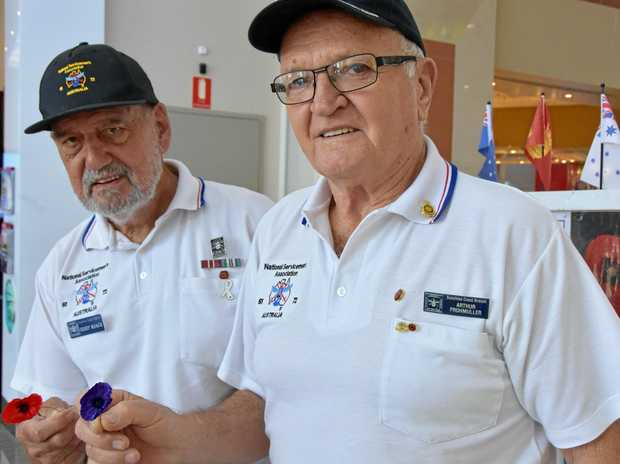 REMEMBERING: Returned servicemen Geoff Roach and Arthur Frohmuller with the Remembrance Day poppies that are popular symbols.