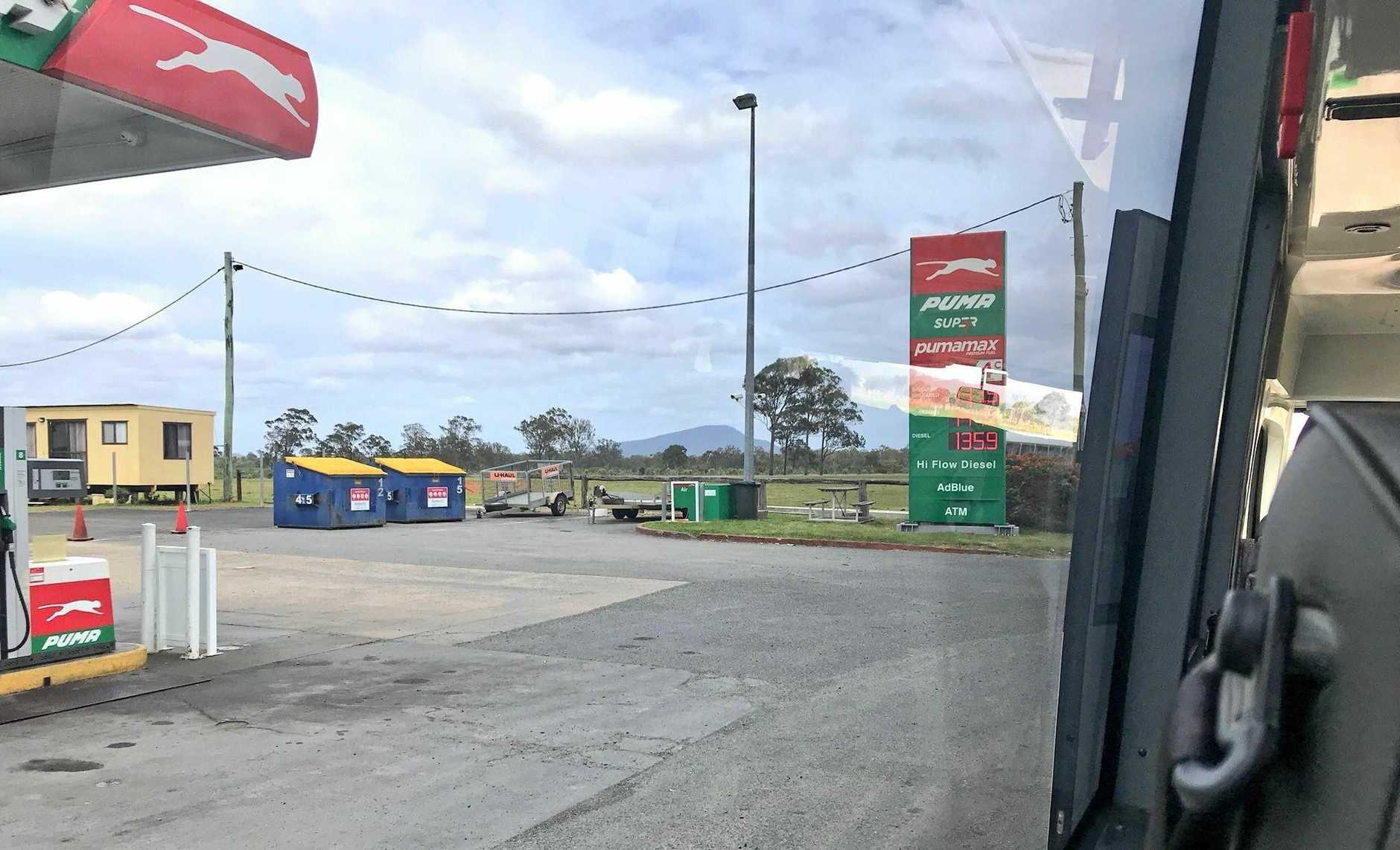 The bus at the fuel station.