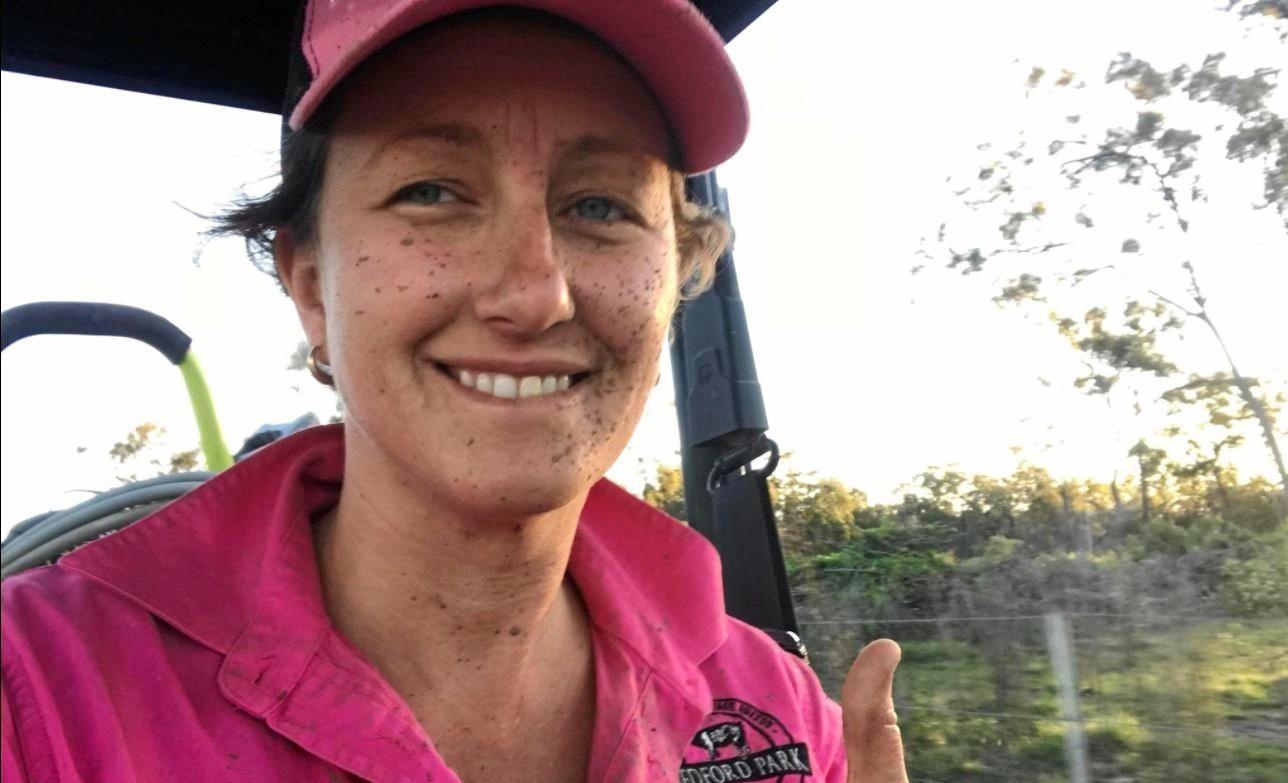 Viv Coleman shows off her muddy complexion after helping deliver 11 piglets after a huge deluge of rain.