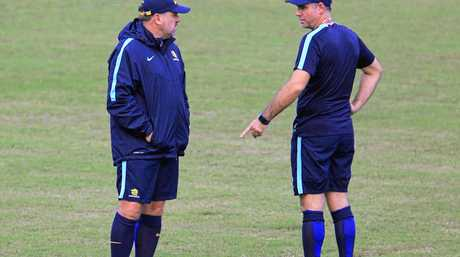 Socceroos coach Ange Postecoglou (left) speaks to his assitant Ante Milicic in San Pedro Sula.