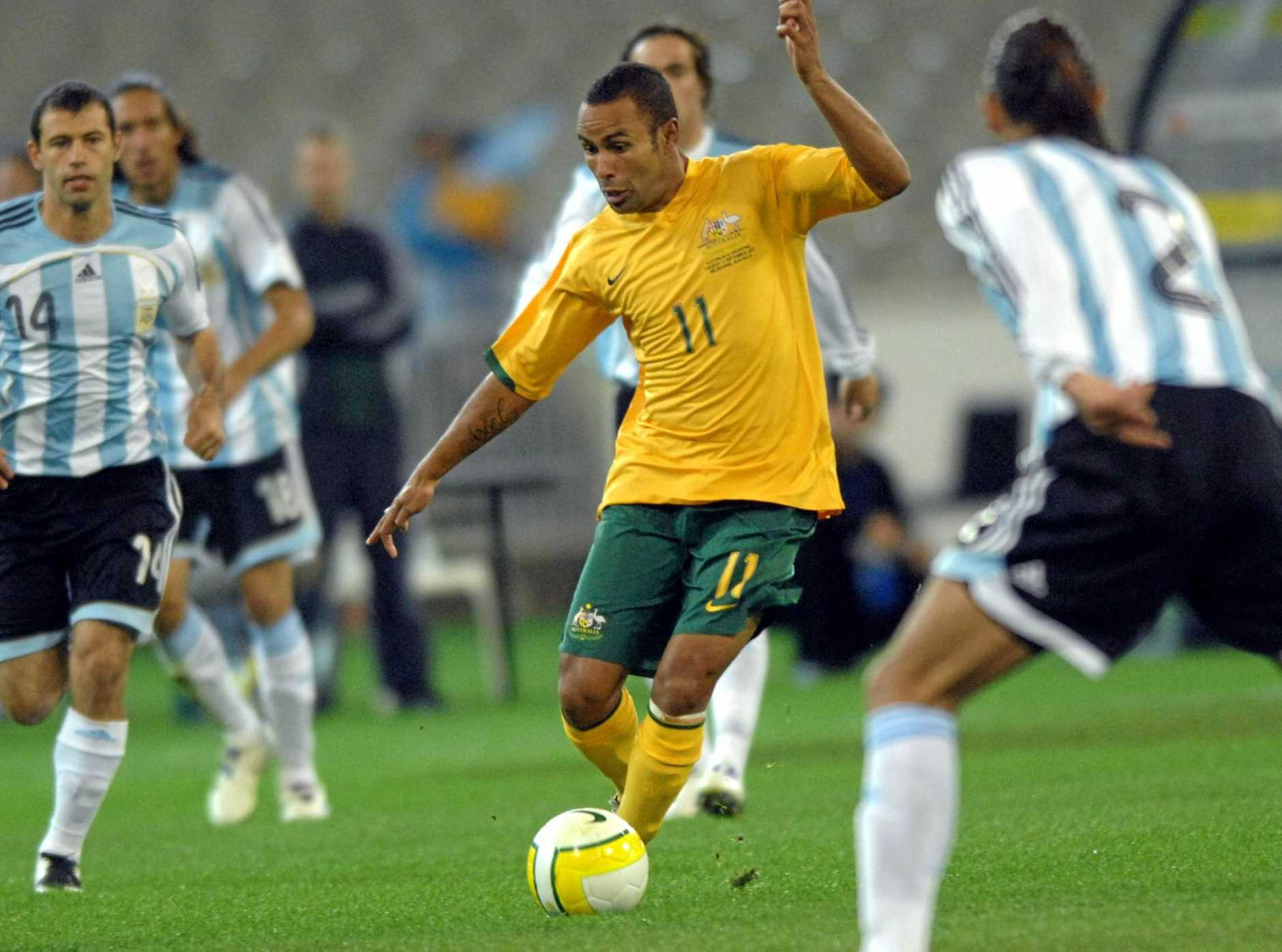 Archie Thompson dribbles the ball as Australia plays Argentina in an international friendly in 2007.