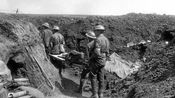 BLOODSHED: Stretcher bearers of the 8th Battalion carry wounded soldiers back along the trenches during the fighting at Bullecourt.