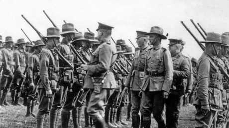 ATTENTION: Colonel John Monash and unidentified officers inspecting the 13th Battalion.
